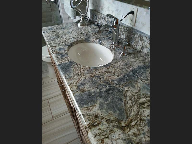 The length of this bathroom counter shows off Diamond Wave Granite's spectacular colors.