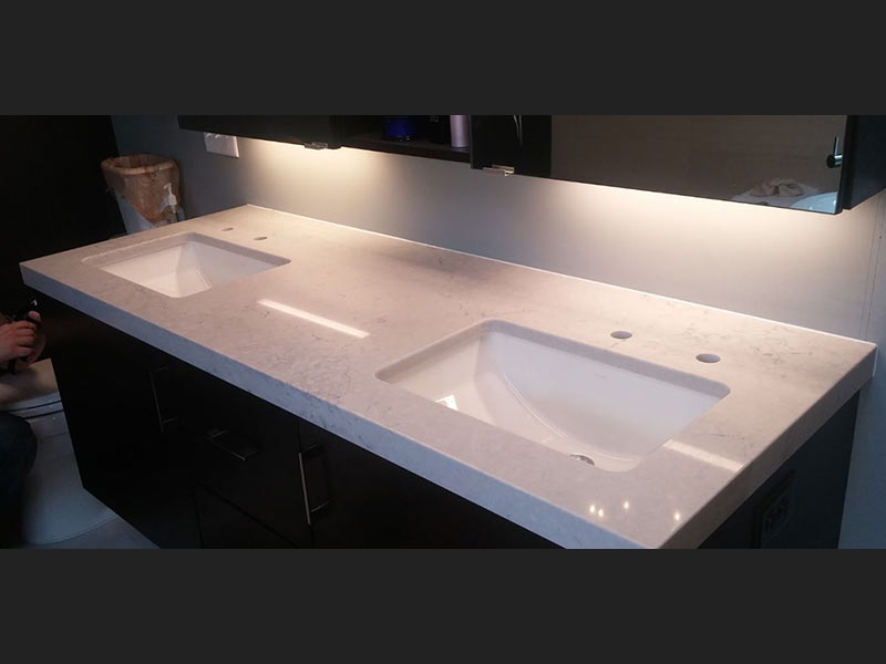 Noble Gray Quartz bathroom counter top with double sinks.