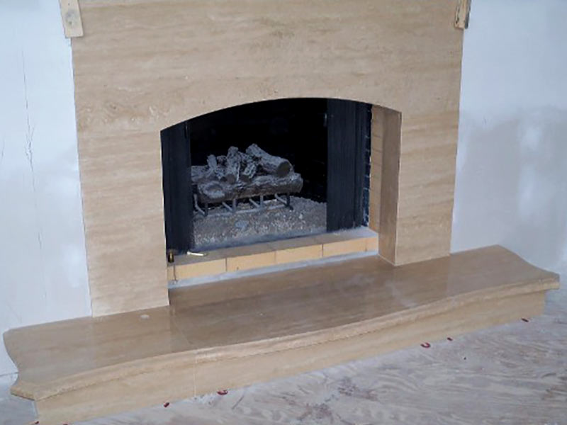 Roman Travertine fireplace surround and hearth.