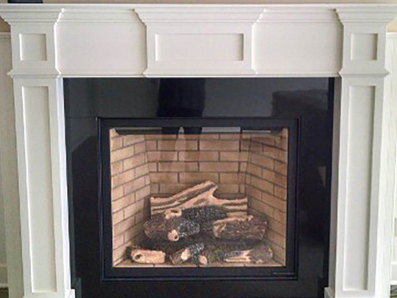 Black Absolute, or Absolute Black, Granite fireplace surround and mantle.
