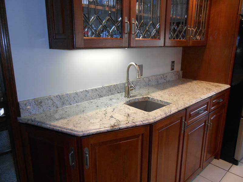 A Delicatus Granite counter takes center stage in this bar!