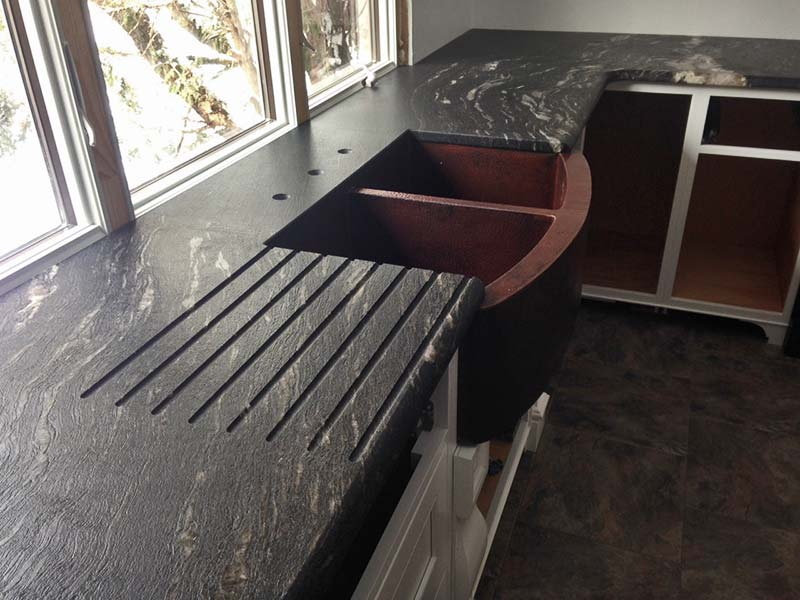 Leathered & Enhanced Black Cosmic Granite kitchen counter with custom drain board.