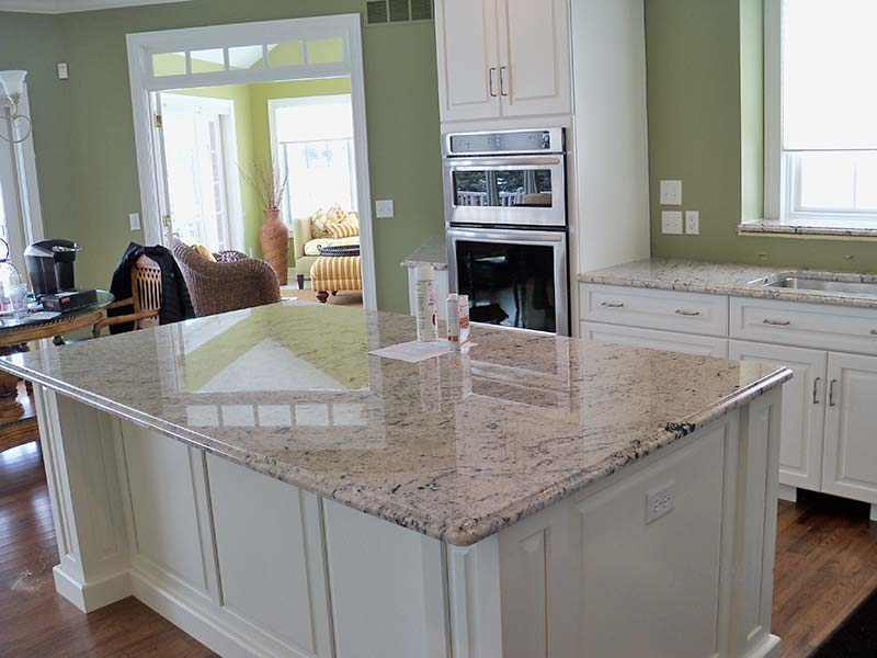 This Delicatus Kitchen island looks great over white cabinets with a light to medium green decor.