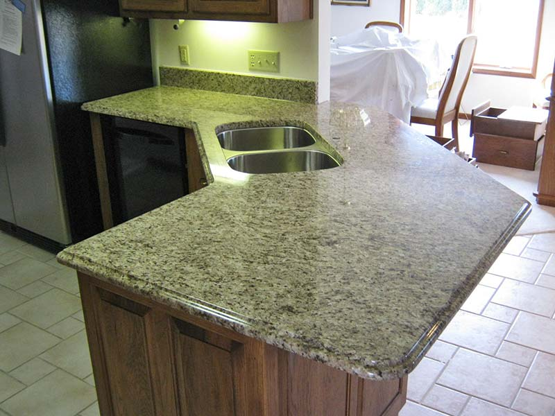 Giallo Ornamental Granite one level peninsula bar for seating.