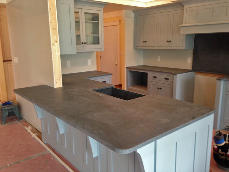 Black Soapstone kitchen counter and island tops.