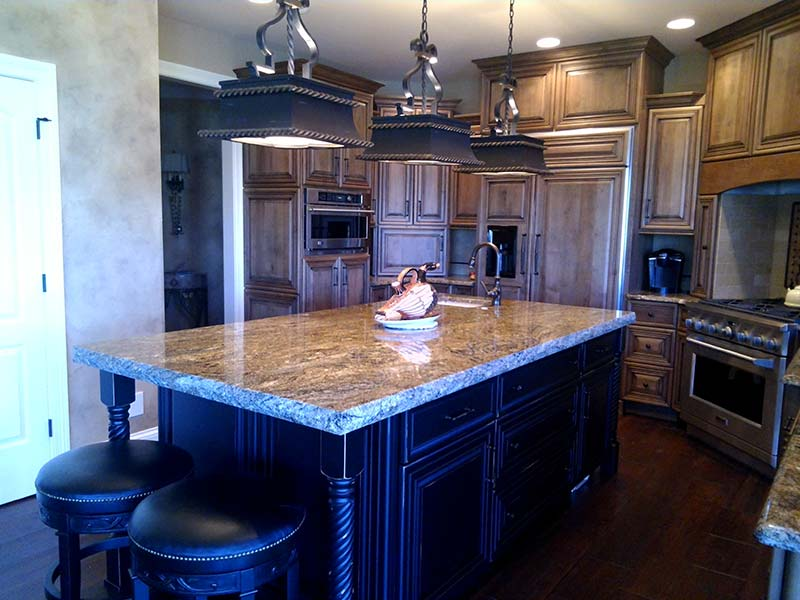 This Stormy Night Granite kitchen island is the focal point of the kitchen.