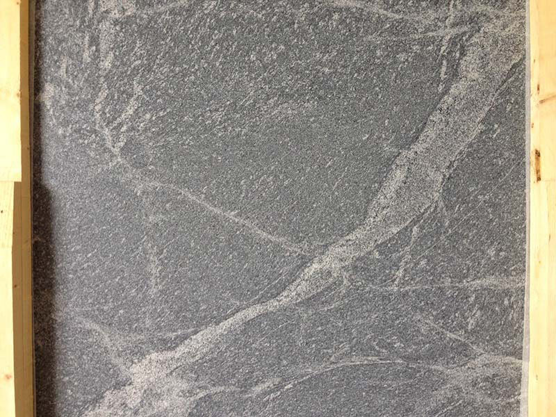 Honed Silver Gray Granite slab with white movement.