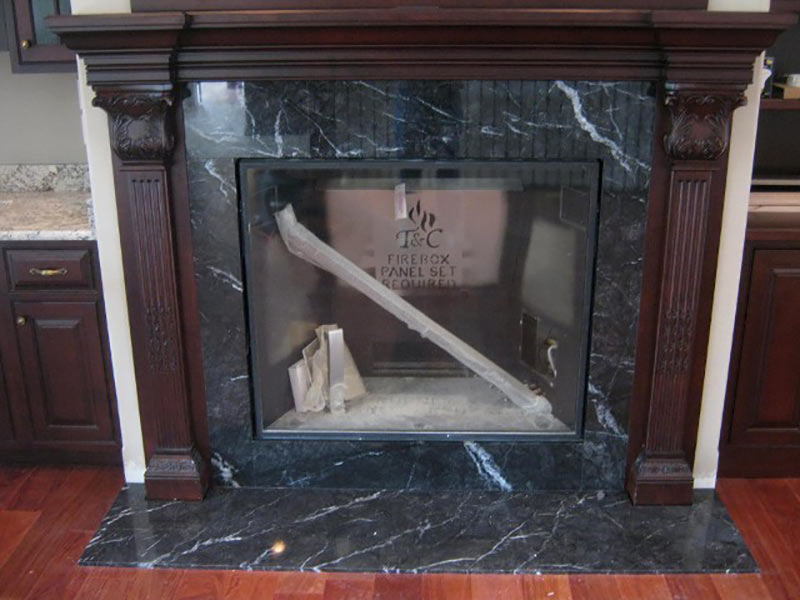 Black Marquina Marble fireplace surround and hearth.