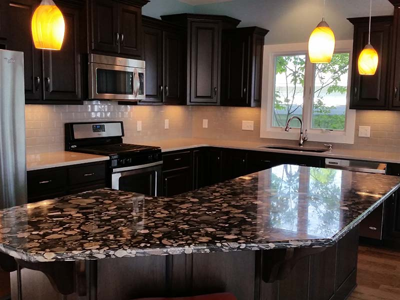 Black Marinace Granite kitchen island becomes the center piece of the room.