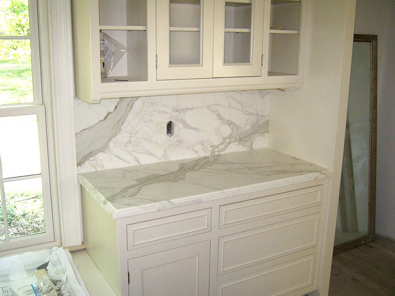 Honed Calacatta Marble kitchen counter and backsplash.