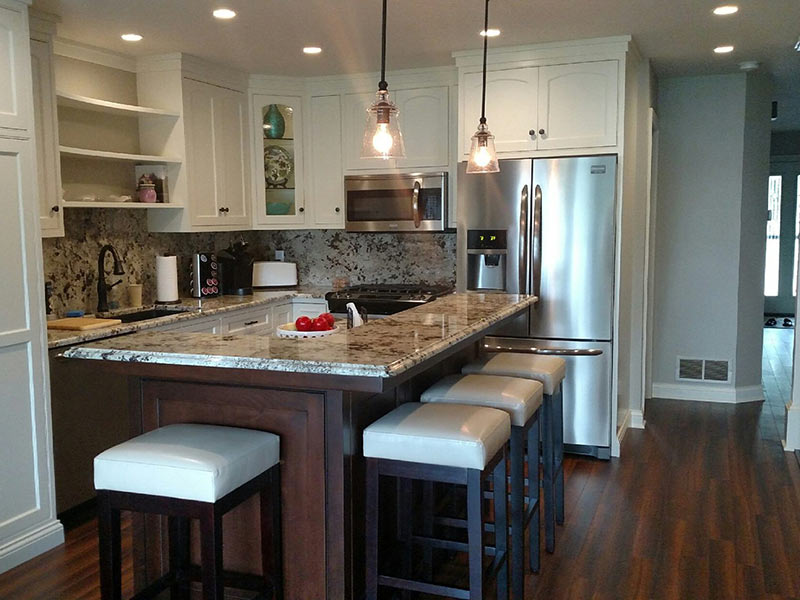 Ice Brown Granite counter and backsplash with darkcabinets