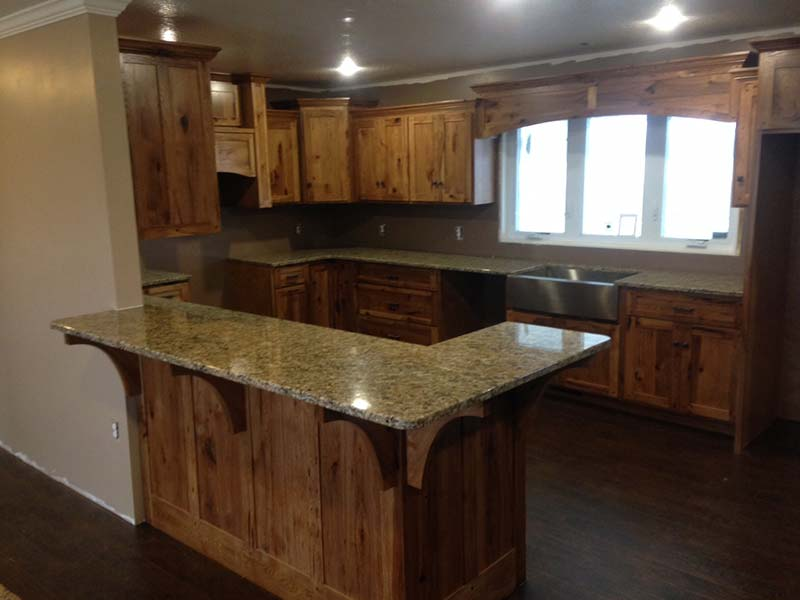 Juperana Gold Granite kitchen island and counters with pine cabinets.
