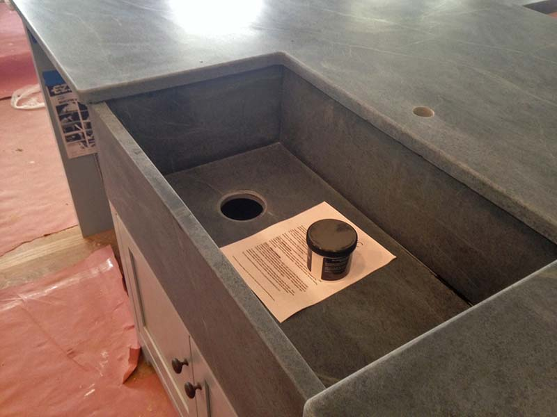 Black soapstone kitchen counter and sink.