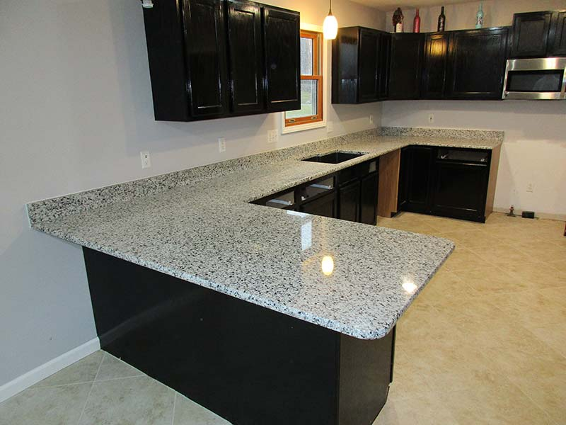 Valle Nevado Granite counters and black cabinets in the kitchen? Yes Please!