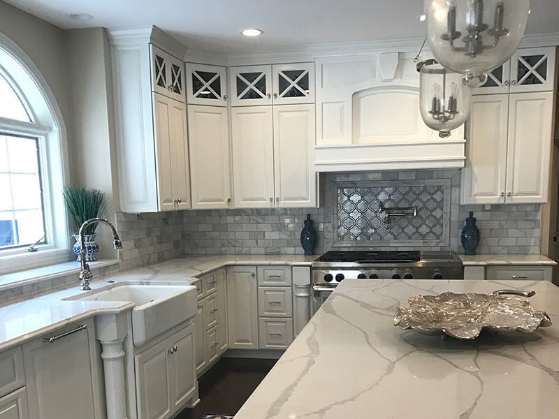 White Quartz with large vein pattern - close up of kitchen island and counter tops