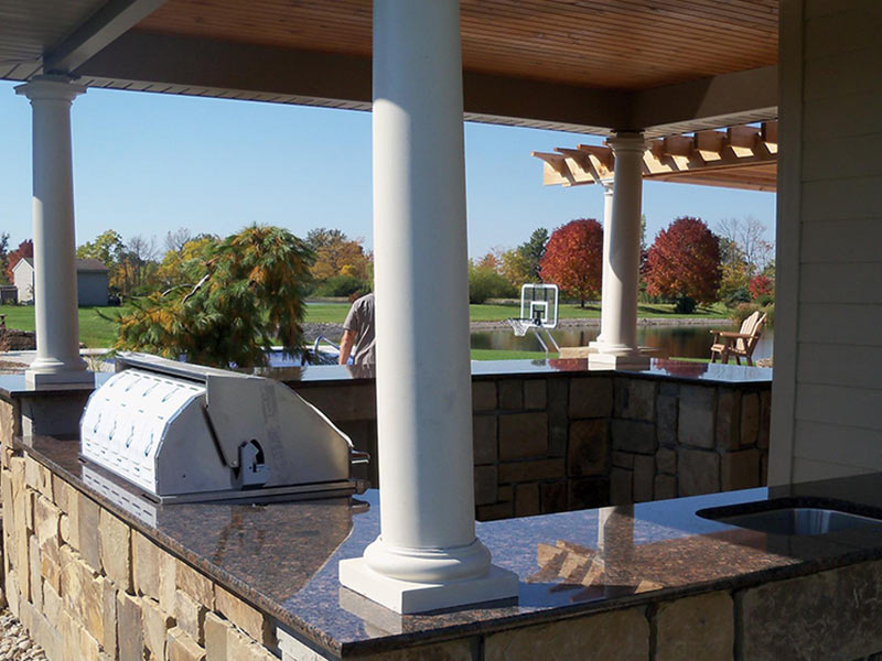 Imperial Coffee Granite sets off this outdoor kitchen.
